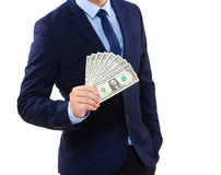 Businessman holding money Royalty Free Stock Images