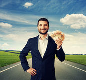 Businessman holding money at outdoor Stock Photo