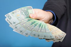 Businessman holding money polish banknote Royalty Free Stock Images