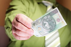 Businessman holding money 100 polish zloty Stock Images