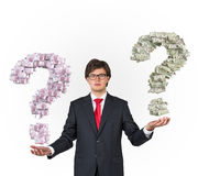 Businessman holding money question mark Stock Photography