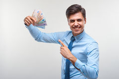Businessman holding money. Success and wealth. Royalty Free Stock Photography