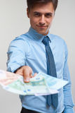 Businessman holding money. Success and wealth. Stock Photo