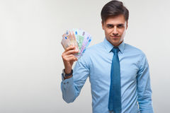Businessman holding money. Success and wealth. Stock Images
