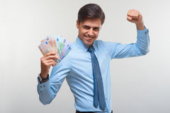 Businessman holding money. Success and wealth. Royalty Free Stock Image