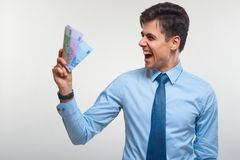Businessman holding money. Success and wealth. Royalty Free Stock Photos