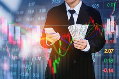 Businessman holding money us dollar bills on digital stock marke. T financial exchange information and trading graph background Stock Images