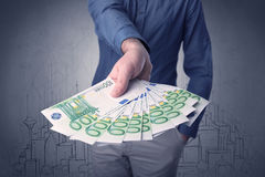 Businessman holding money Stock Images