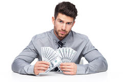 Businessman holding money Royalty Free Stock Photo