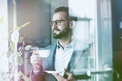 businessman holding morning cup of coffee stock photo