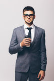 Businessman holding mug of coffee Stock Photo