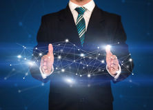 Businessman holding network connections Royalty Free Stock Image