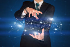 Businessman holding network connections Stock Photo