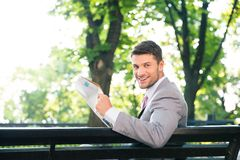 Businessman holding newspaper Royalty Free Stock Image
