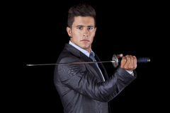 Businessman holding a ninja sword Stock Photography