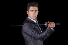 Businessman holding a ninja sword Stock Photography