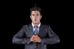 Businessman holding a ninja sword Stock Images