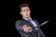 Businessman holding a ninja sword Royalty Free Stock Photos