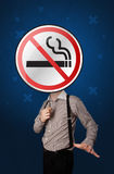 Businessman holding no smoking sign. Casual businessman holding round sign with no smoking graphic stock images