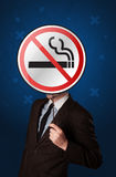 Businessman holding no smoking sign. Smart businessman holding round sign with no smoking graphic stock photography