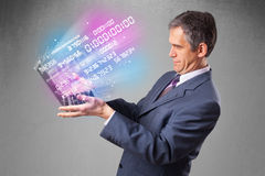 Businessman holding notebook with exploding data and numbers. Attractive businessman holding notebook with exploding data and numbers Stock Photography