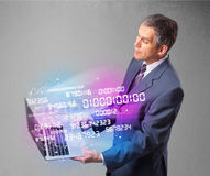 Businessman holding notebook with exploding data and numbers Royalty Free Stock Photography