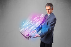 Businessman holding notebook with exploding data and numbers Royalty Free Stock Image