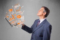 Businessman holding notebook with graphs and statistics Royalty Free Stock Photo