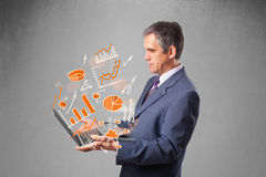 Businessman holding notebook with graphs and statistics Stock Image