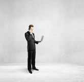 Businessman holding notebook. And talking on phone Royalty Free Stock Images