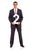 Businessman holding number Royalty Free Stock Images