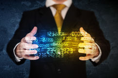 Businessman holding number cloud Stock Photo