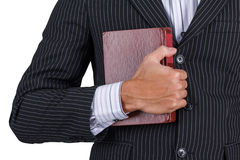 Businessman holding old book Royalty Free Stock Photos