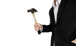 Businessman holding old hammer, isolated on white background. Businessman holding old hammer. isolated on white background Royalty Free Stock Photo