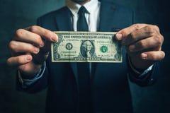 Businessman holding one USA dollar bill Royalty Free Stock Photography