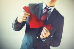 Businessman holding open armed heart with hands - warm welcome a Stock Photo