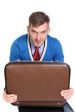 Businessman holding open briefcase in hands Stock Photos