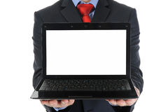 Businessman holding an open laptop Stock Images