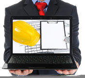 Businessman holding an open laptop Royalty Free Stock Photos