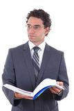 Businessman holding an open notebook Stock Image