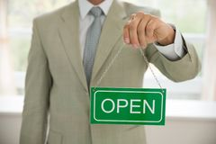 Businessman holding open sign Royalty Free Stock Photo