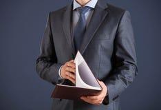 Businessman holding an opened book Stock Photos