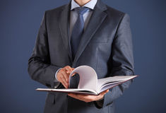 Businessman holding an opened book Royalty Free Stock Photo