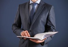 Businessman holding an opened book Royalty Free Stock Images