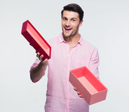 Businessman holding opened gift box Stock Photos
