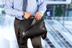Businessman holding and opening  a  leather briefcase Stock Photos