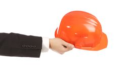 Businessman holding an  orange engineer helmet Stock Photos
