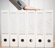 Businessman holding organized documentation in binders, accounting services and bookkeeping concept stock photo