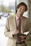 Businessman Holding Organizer Stock Photo
