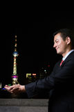 Businessman holding the oriental pearl tower Royalty Free Stock Photography